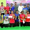 Vishnu wins two titles in state badminton tourney