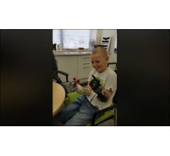 Image for Allan Gifford is the youngest boy in the world with two prosthetic hands