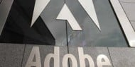 Signet Investment Advisory Group Inc. Trims Position in Adobe Inc
